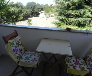 One-Bedroom Apartment with Balcony and Garden View